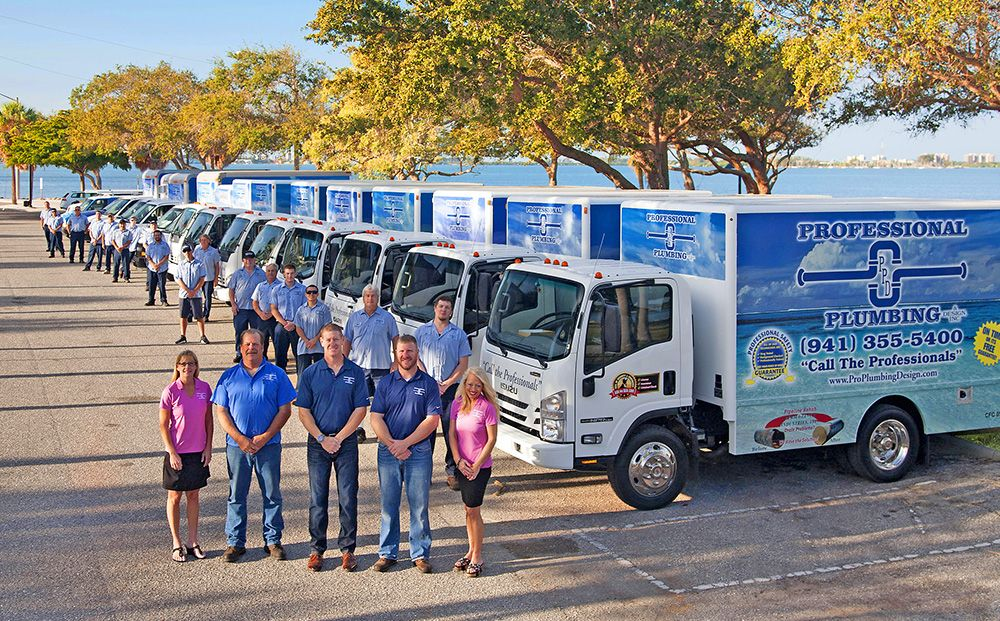 Professional Plumbing & Design team and truck line up at Bayfront Park in Sarasota, Florida.