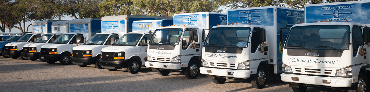 Professional Plumbing & Design trucks parked along Bayfront Park in Sarasota, Florida.