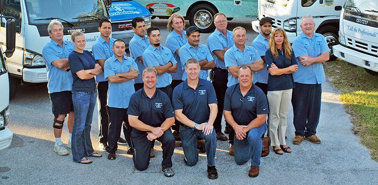 sarasota plumbing team in front of trucks